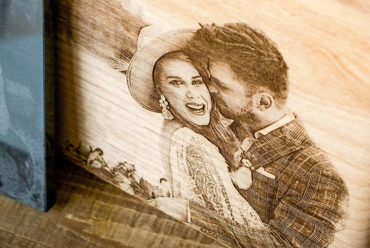 Close-up of a wedding photo engraved on wood