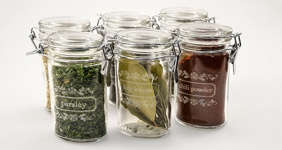 Laser etched glass jars.