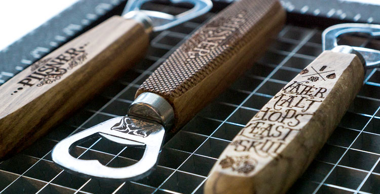 Bottle openers engraved with a dual source Epilog laser machine