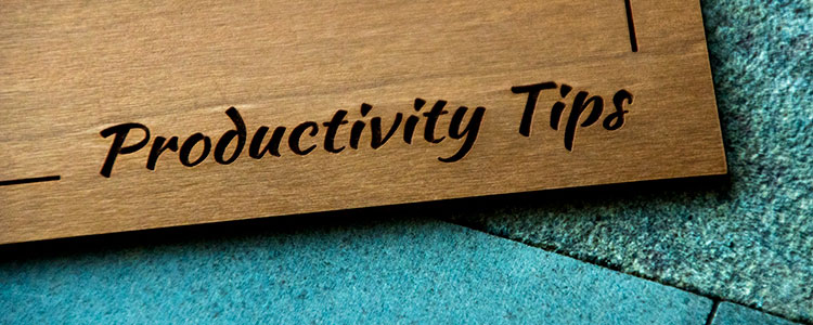 Wood engraved with 'productivity tips'