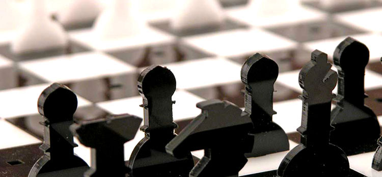 An acrylic chess set cut with an Epilog Laser