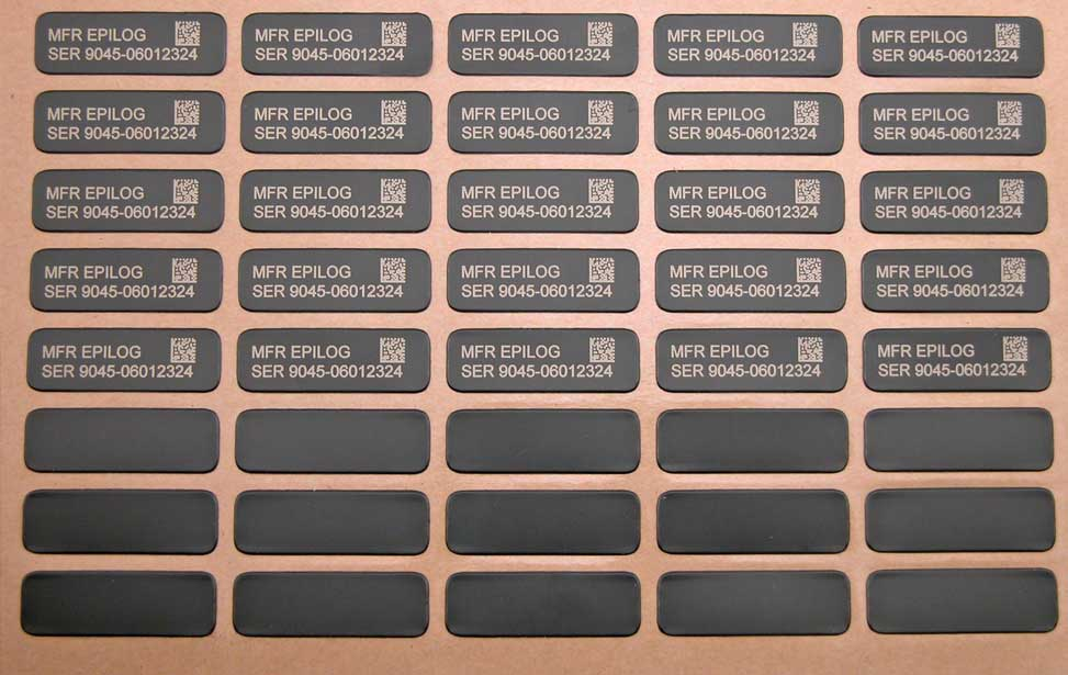 Laser engraved sheet of multiple labels.