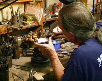 John working on a grammy.