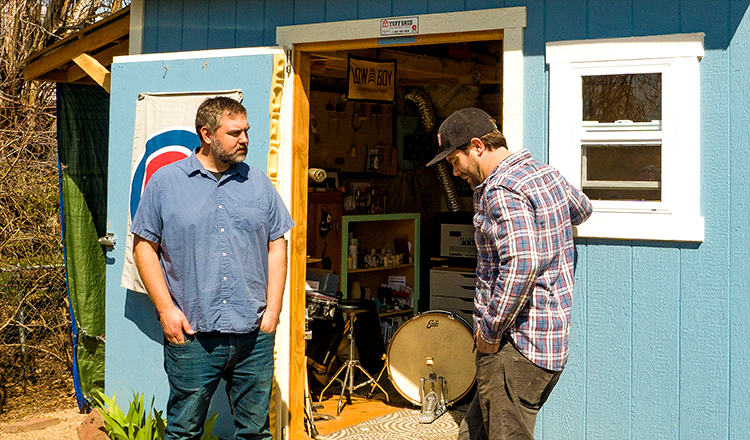 Jeremy Brieske and Chris Gregori standing outside the Low Boy Custom Beaters workshop.