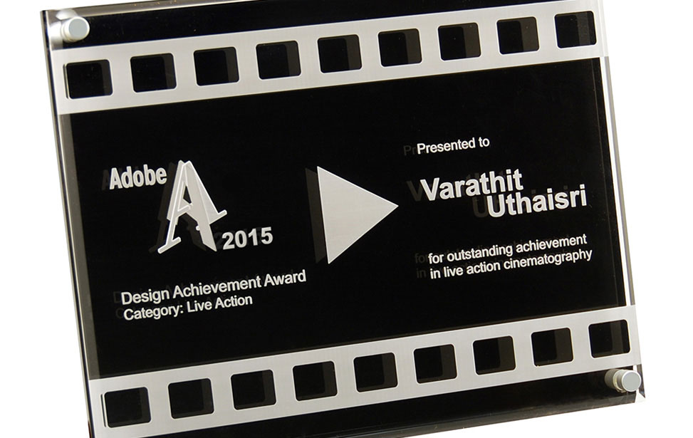 Acrylic Adobe award engraved with an Epilog