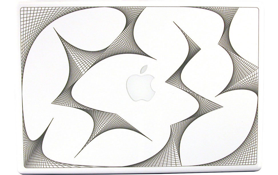 Geometriske figurer gravert på Macbook