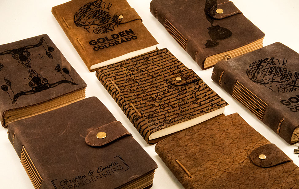 An assortment of laser engraved leather diaries