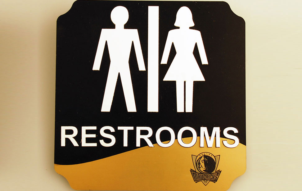 Engraved and cutting lettering for a men or women bathroom sign