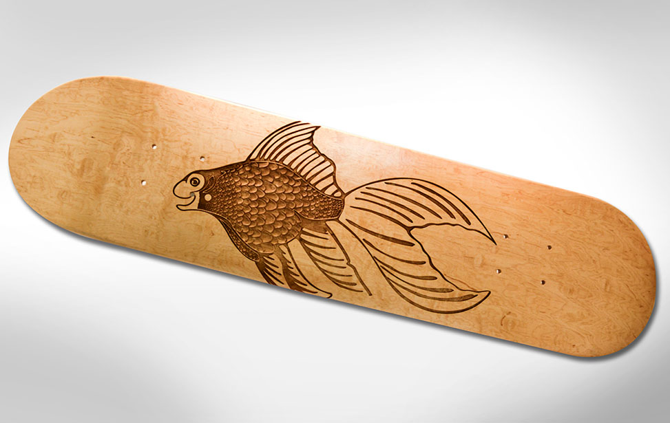Fish Design Engraved on a Skate Board