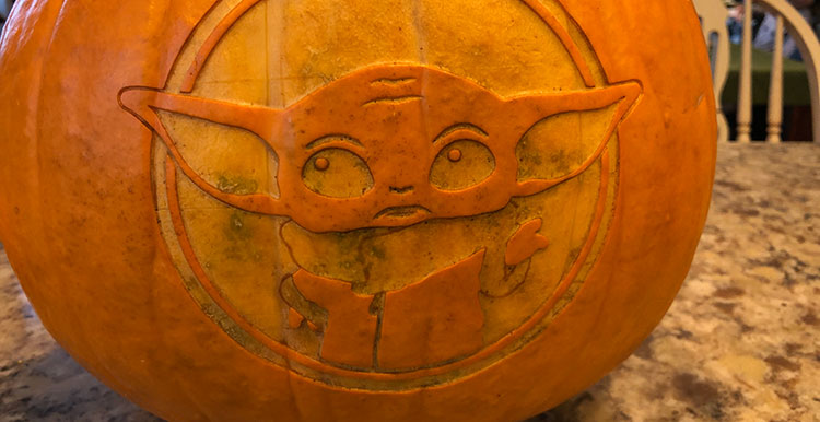 pumpkin laser engraved with an image of baby yoda