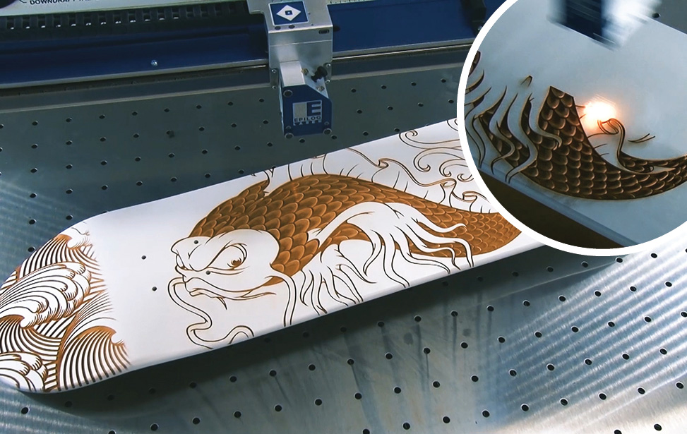 laser engraving a wooden skateboard deck
