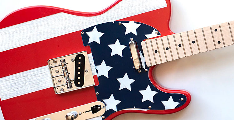 Laser engraving Fourth of July guitar.