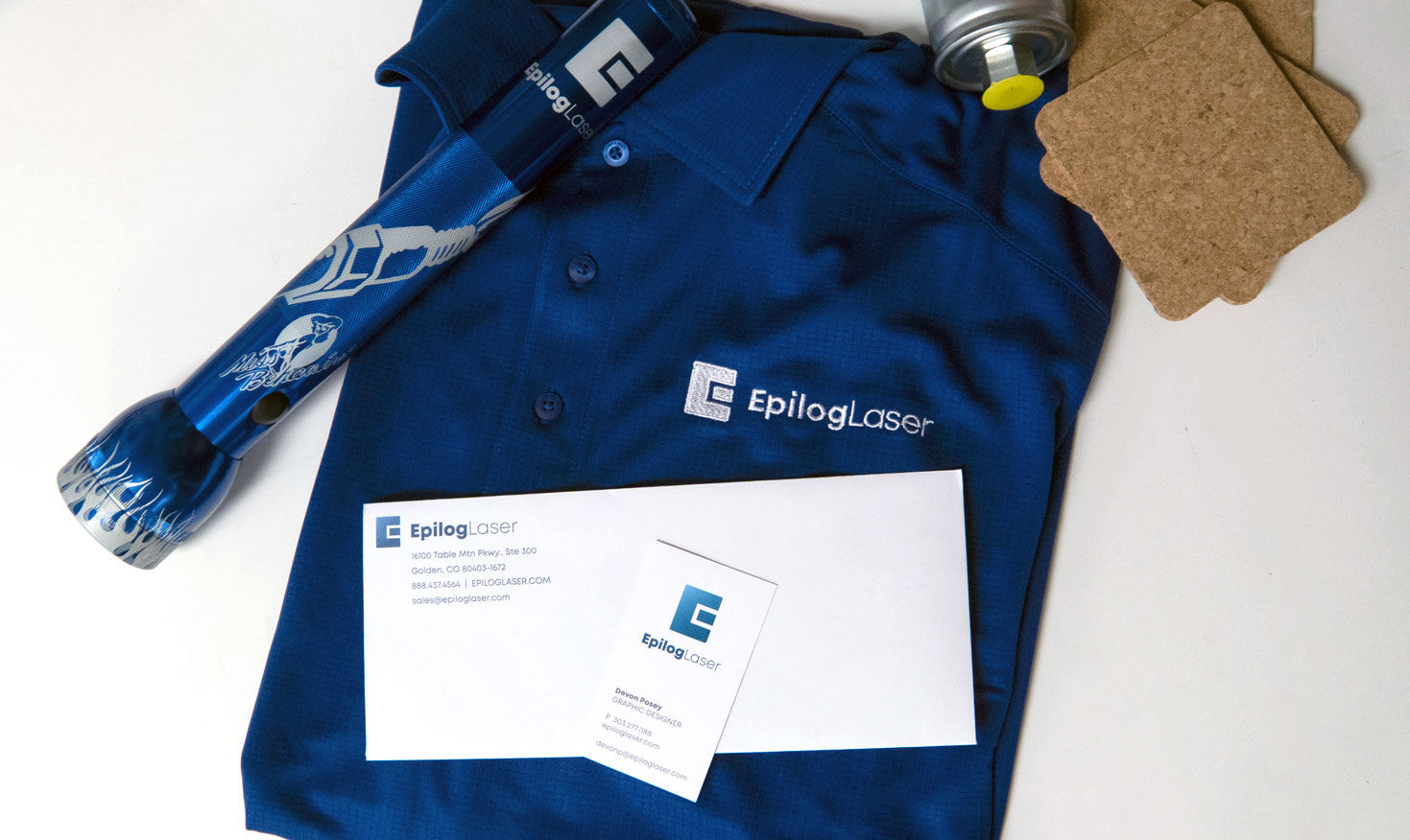The new Epilog Laser logo on a shirts and stationary.