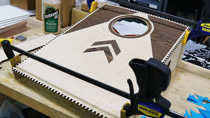 Glueing and assembly of cornhole