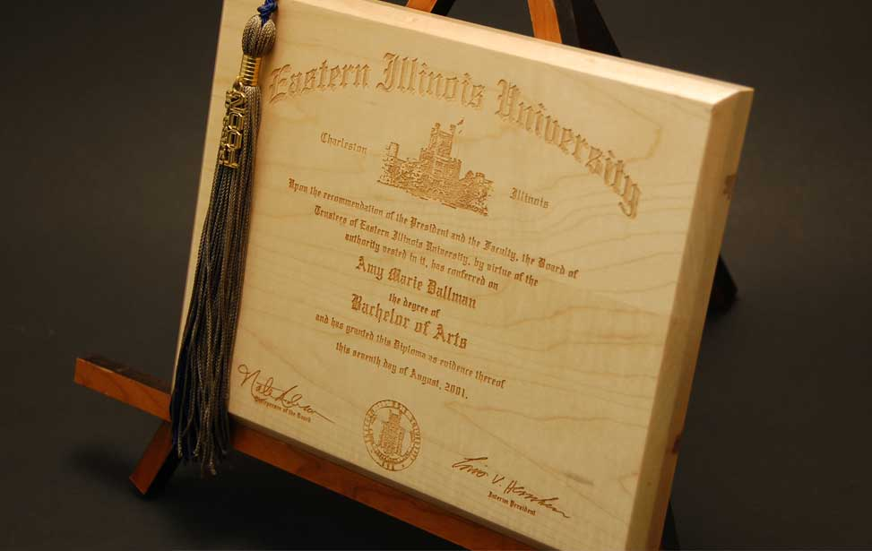 Laser etched wooden diploma.