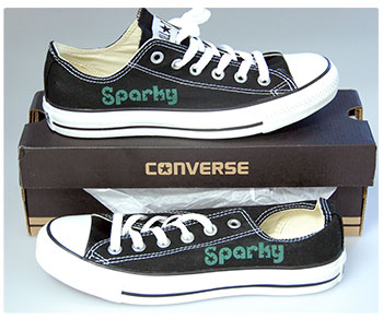 Laser engraved converse shoes.