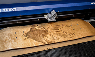 Finished engraving of the skateboard in the laser.