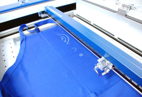 The laser as it engraves the apron.