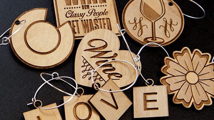 Wood wine charms created with a laser.