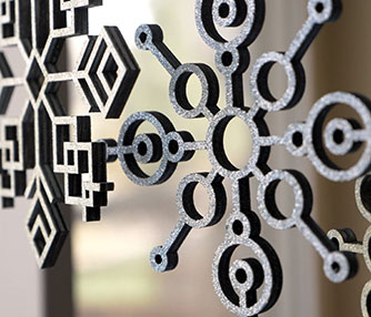 Laser cut plywood snowflakes