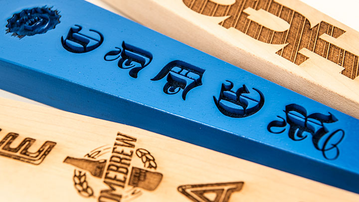 detail shot of engraved beer tap handles