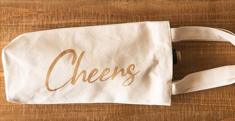 Laser engraved canvas wine bag that says 'cheers.'