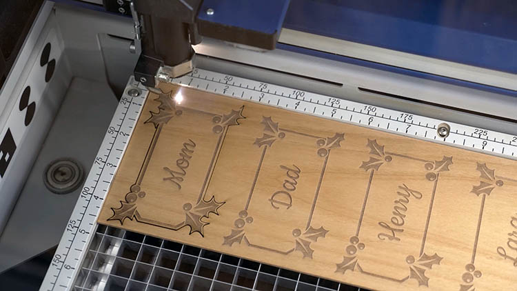 Laser cutting sheet of wood
