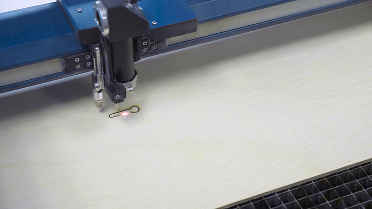 Epilog Laser machine cutting out a keyhole slot