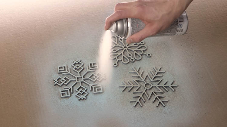 Spray painting laser cut snowflakes
