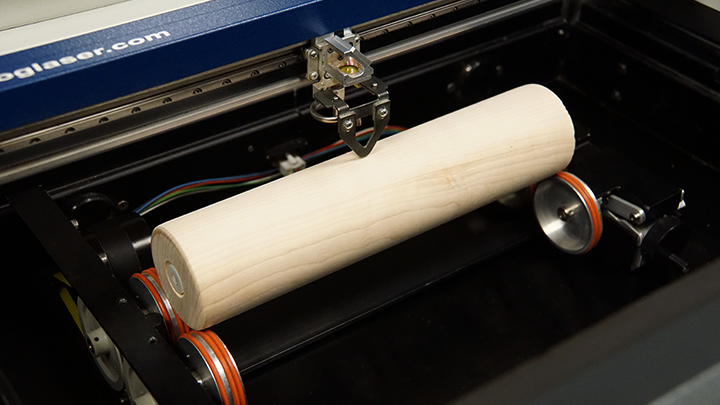 A rolling pin placed on a rotary device in the laser system