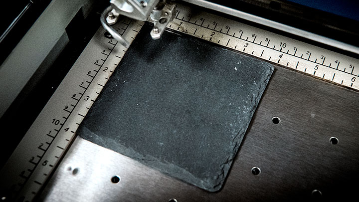 slate coaster placed in laser system