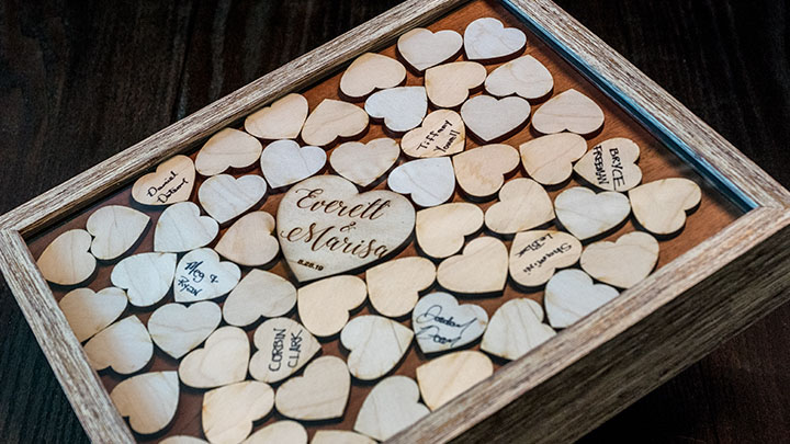 detail of custom laser engraved wedding guestbook shadow box
